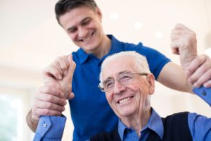 Baudry Physical Therapy Center PT Assessing Senior By Raising Arms